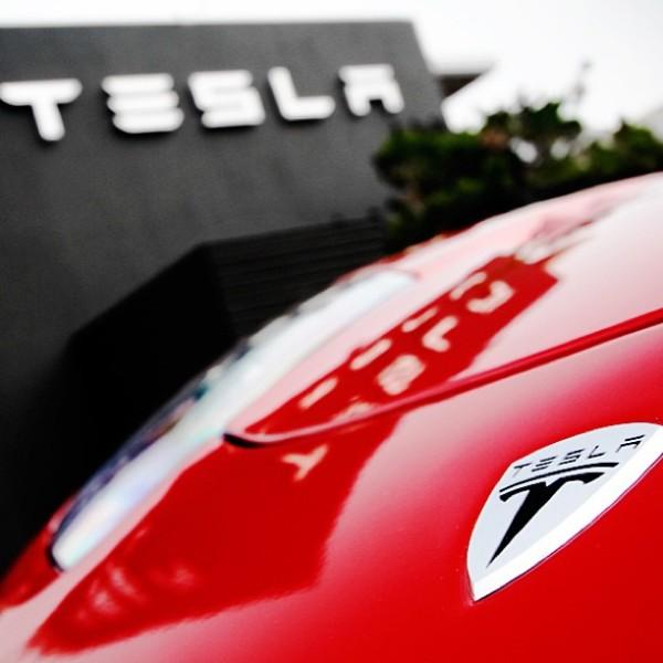 tesla-logo-red-hood