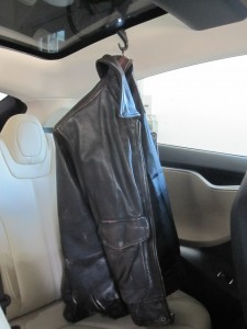 Tesla Model S coat hook with leather bomber jacket