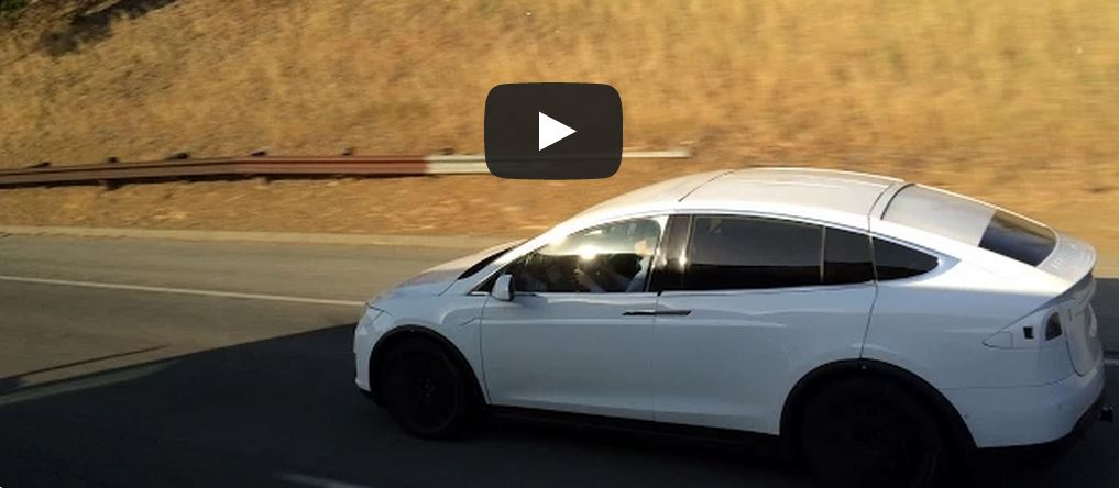 Tesla Model X undergoing lane departure test on the freeway