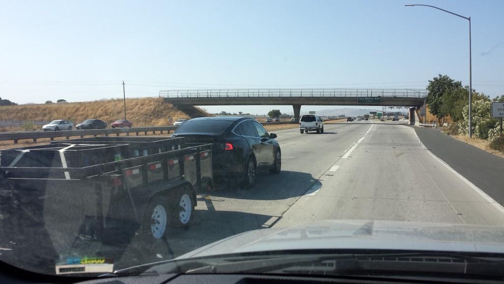 Tesla Model X hauling freight down Hwy 101