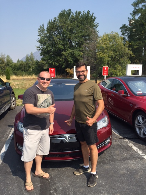 Jerome Guillen poses with Tesla owner at Mt Shasta Supercharger