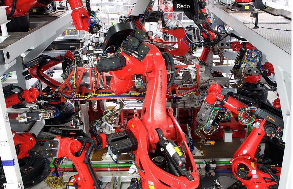 Robots on reconfigurable Tesla assembly line