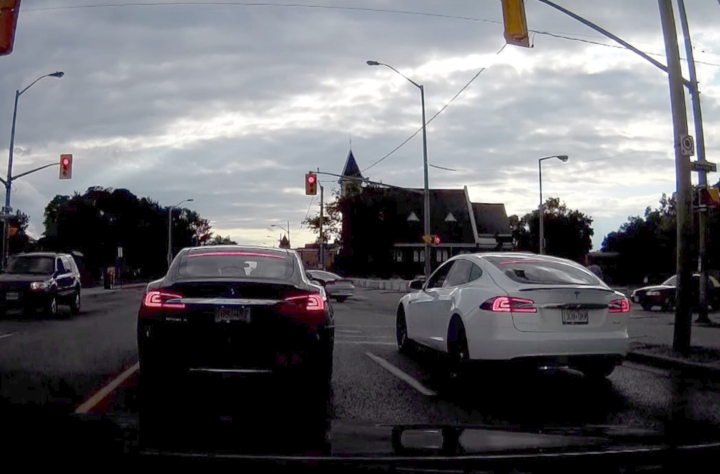 Two Tesla Model S face off at traffic light