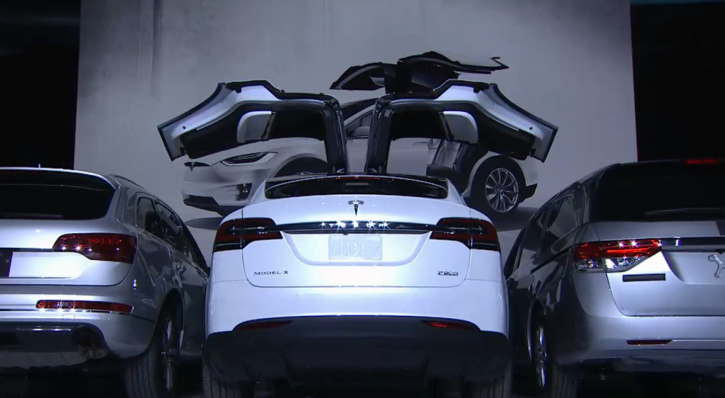Model X Falcon Wing Doors Open Between Parked Cars