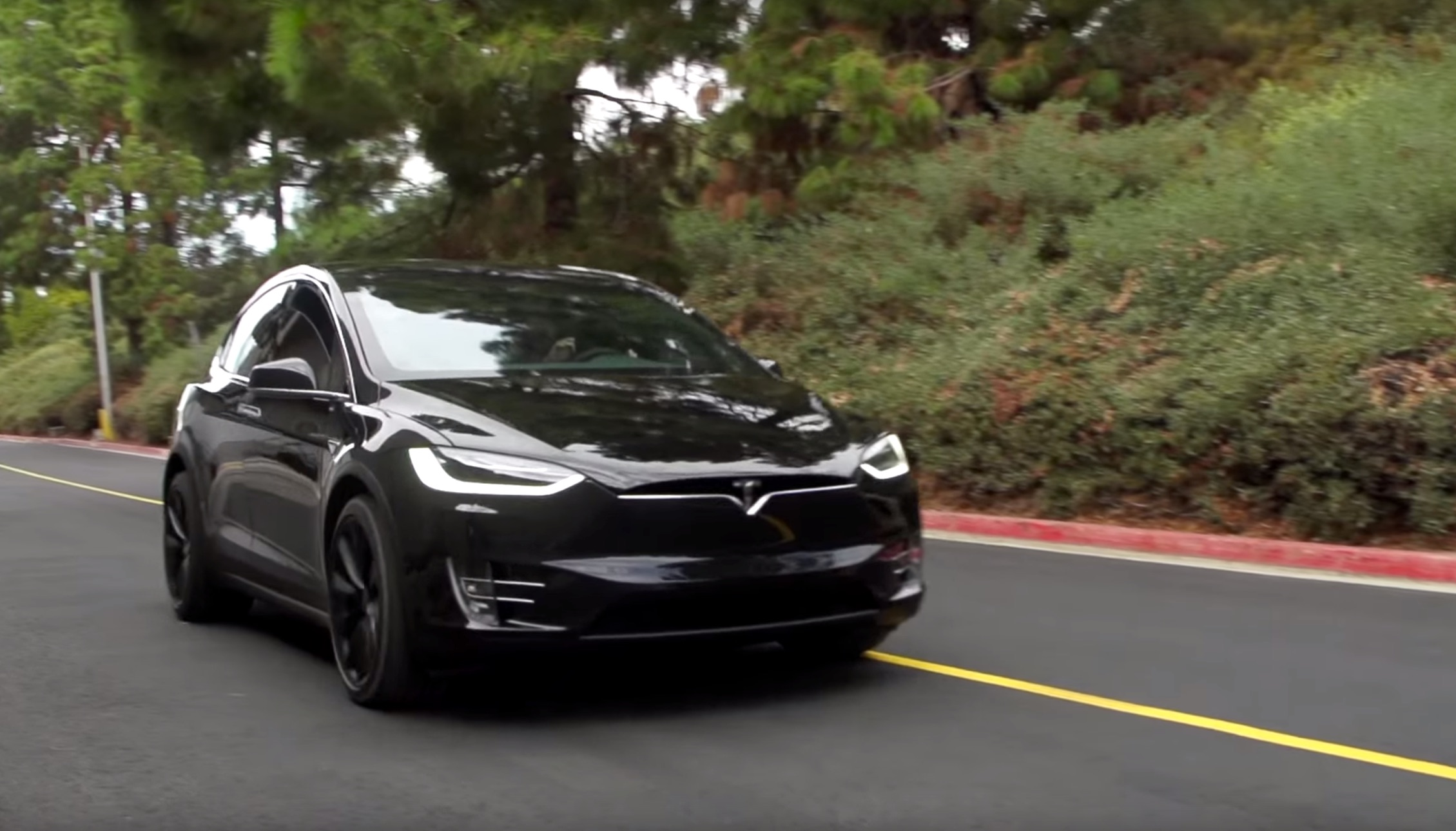 Black-Tesla-Model-X-Road