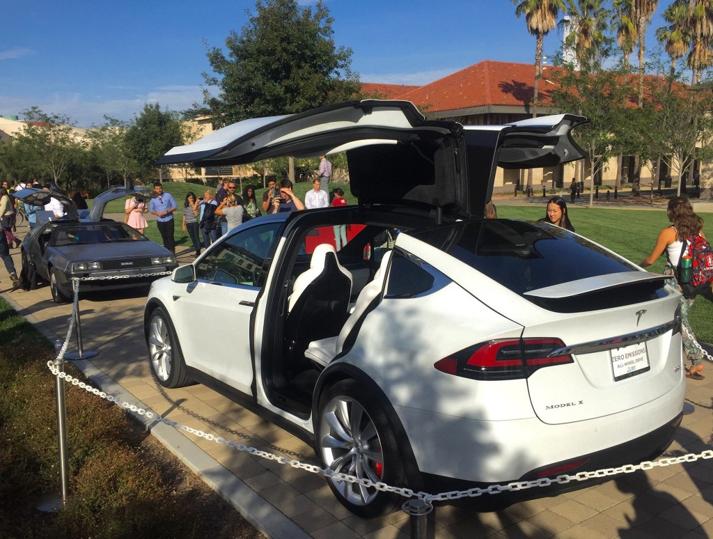DeLorean gull wing doors vs Tesla Model X falcon wing doors at STVP Future Fest [Source: Facebook via Steve Jurvetson]