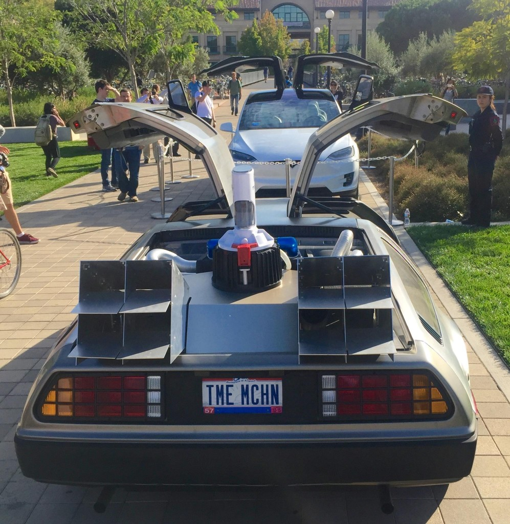 DeLorean gullwing doors vs Tesla Model X falcon wing doors at STVP Future Fest [Source: Facebook via Steve Jurvetson]