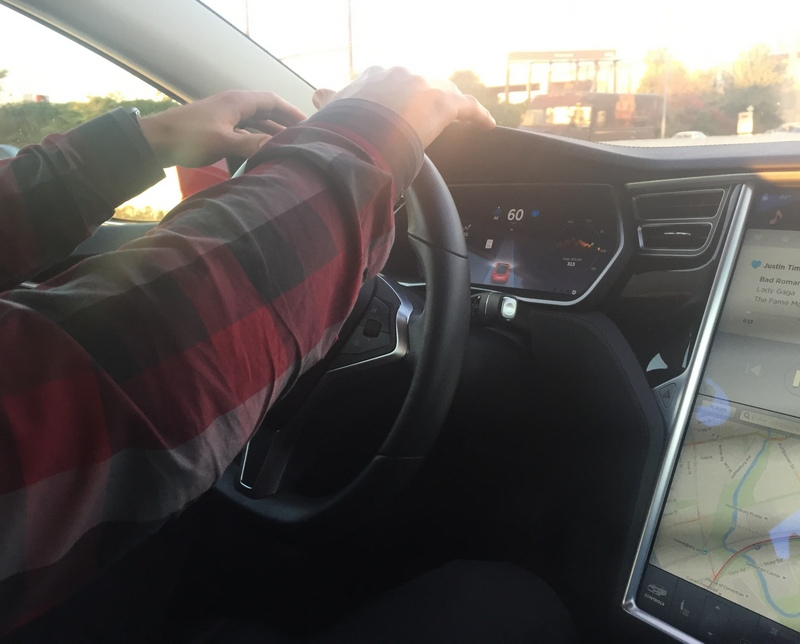 Hovering hands above steering wheel with Autopilot