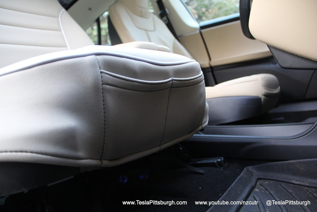 Model S front seat covers with storage