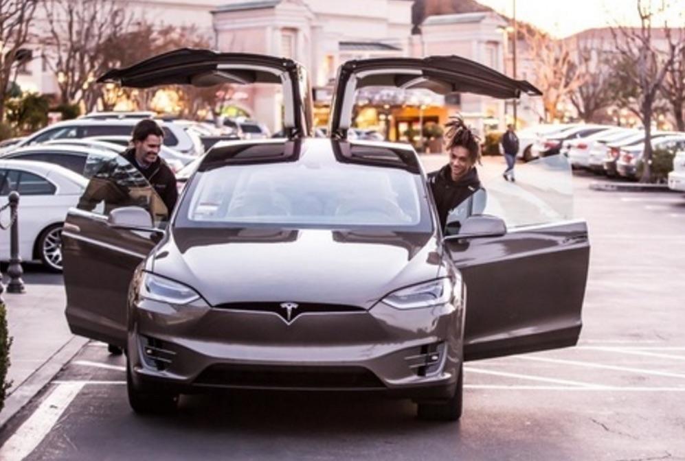 Jaden Smith poses with Tesla Model X