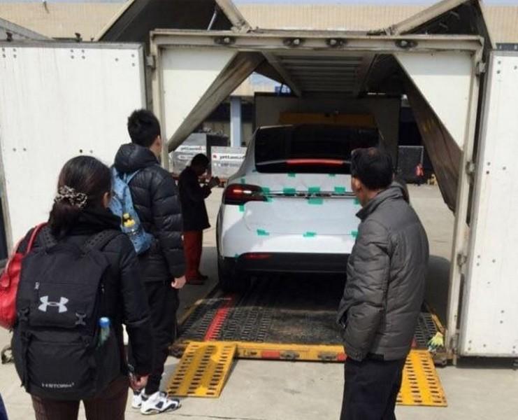 Model X unloading at Beijing airport cargo terminal