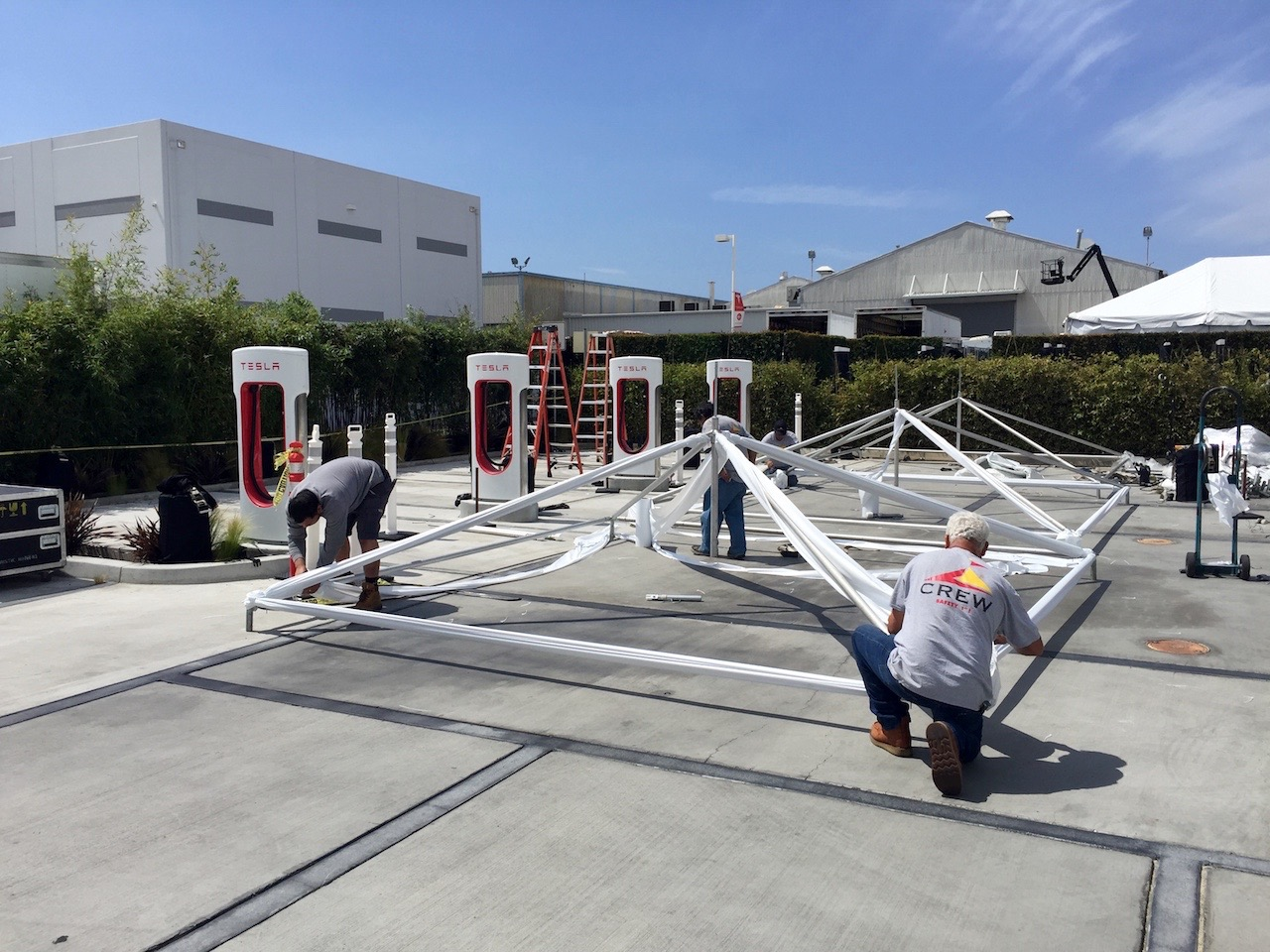 Tesla staff setting up tents for the Model 3 event