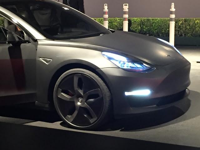 Matte Black Tesla Model 3 with low profile tires