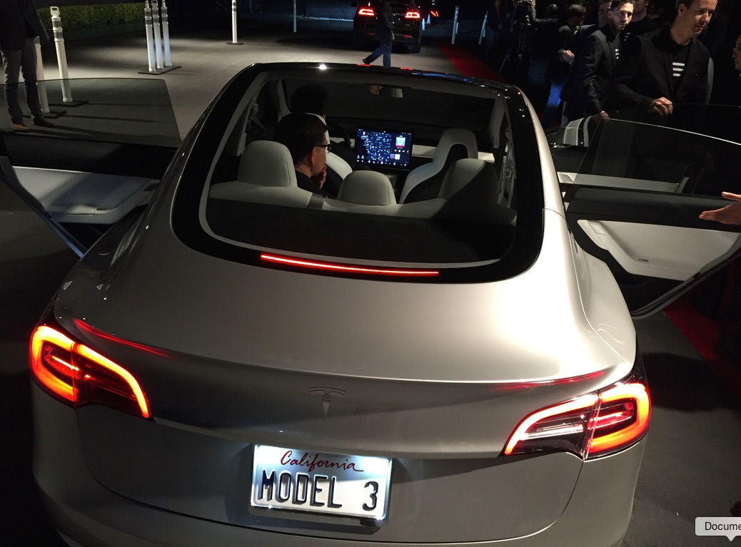 The Tesla Model 3 is here and it's ridiculously sexy