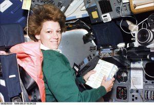 Eileen Collins flexing her commanding skills in space.