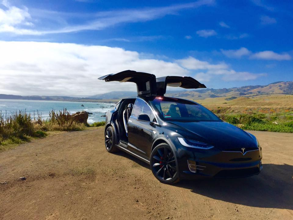 Black-Tesla-Model-X-falcon-wing-ocean-coastline