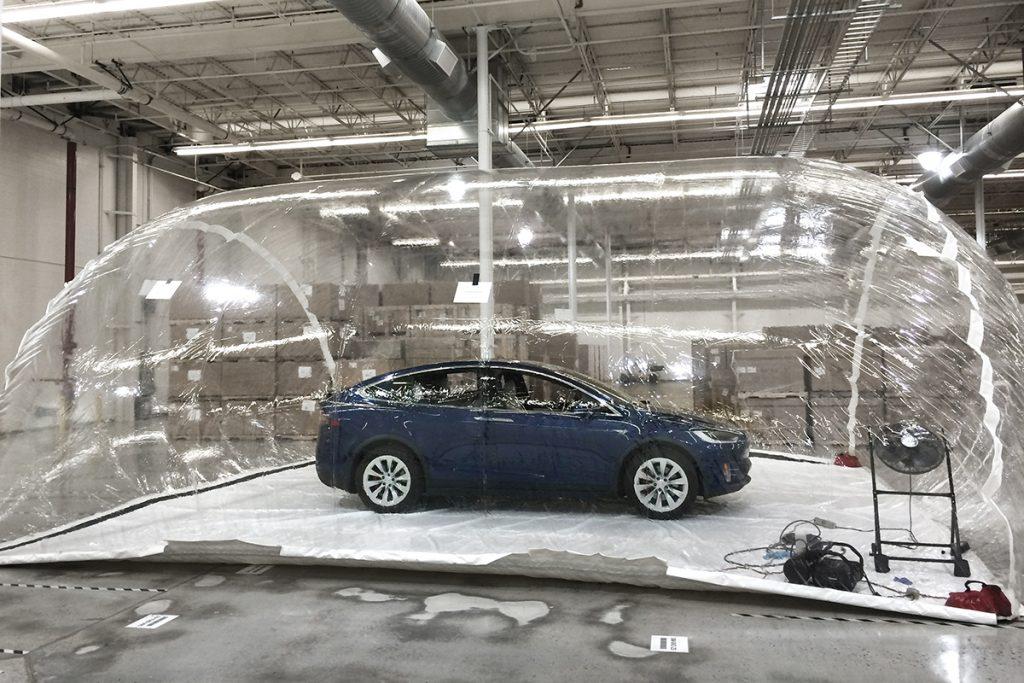 Tesla Model X testing Bioweapons Defense Model inside biohazard bubble