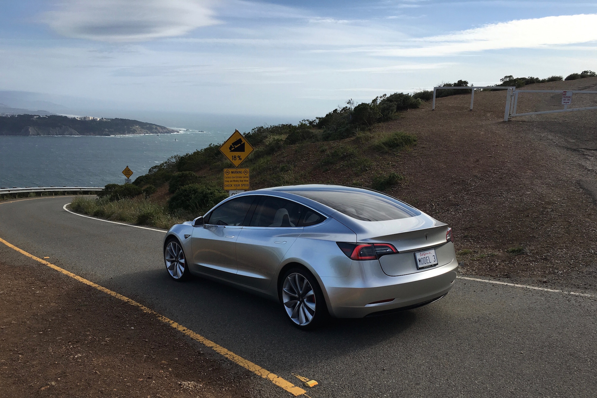 Silver Tesla Model 3 overlooking SF bay
