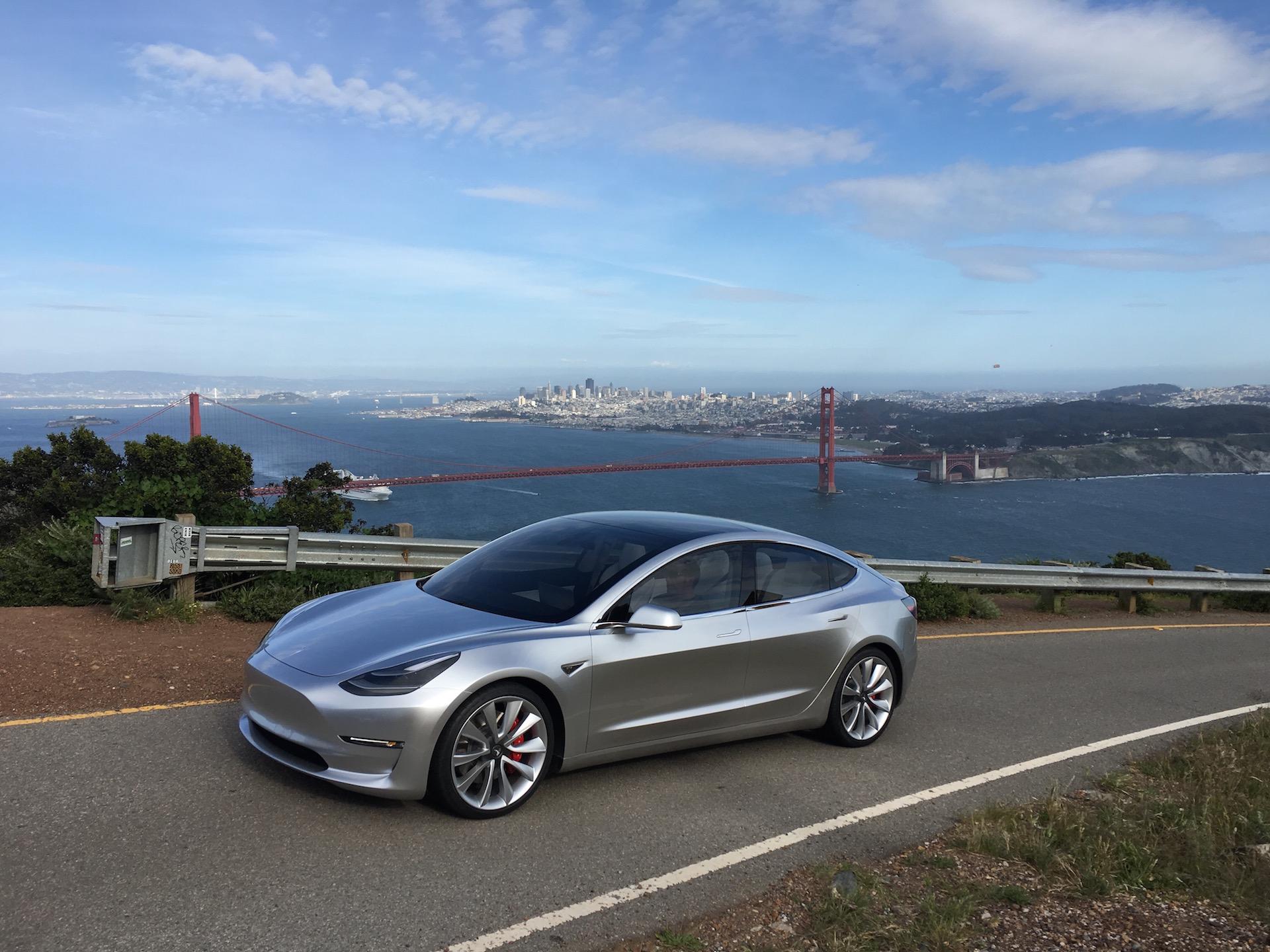 Silver Tesla Model 3 overlooking San Francisco
