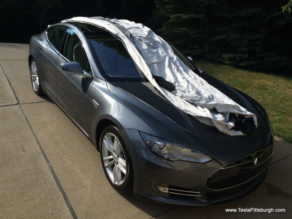 Unfolding the Tesla Model S car cover