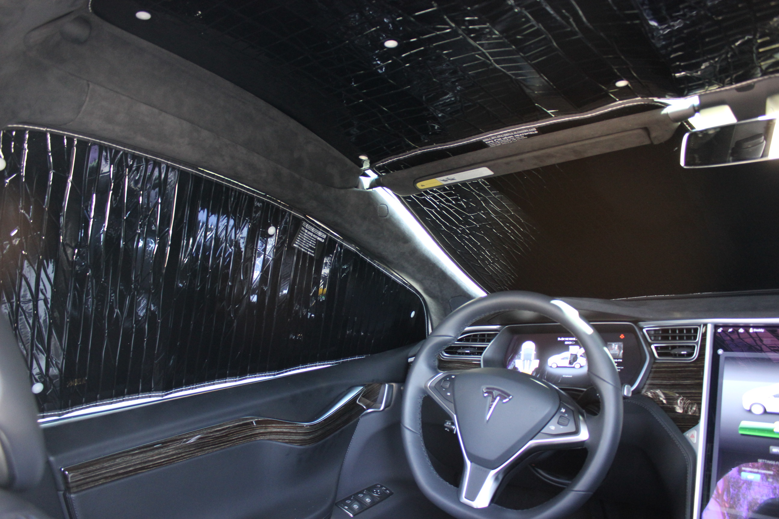 A near blackout effect with all Model X HeatShield Sunshades in place
