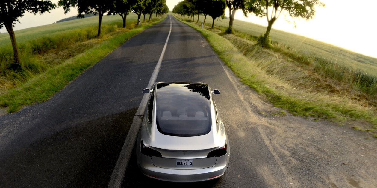 Silver-Tesla-Model-3-open-road