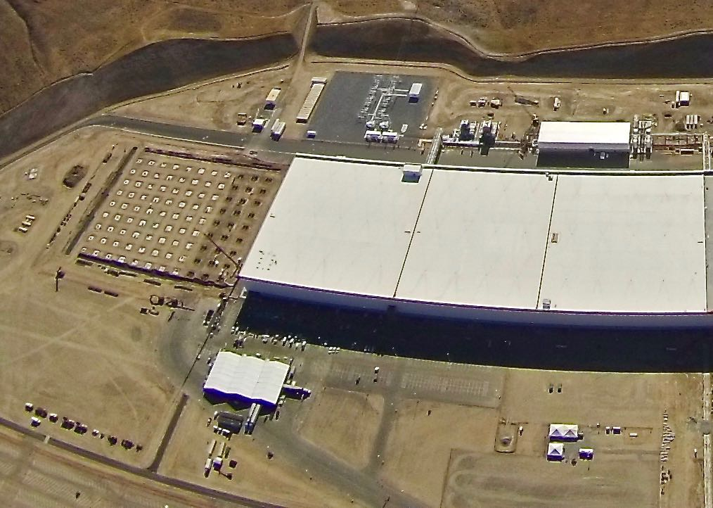 A newly perched white tent is seen near the entrance to the Gigafactory
