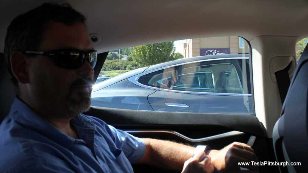 looking through rear windows of head to head comparison with light harmonics labs speakers tesla pittsburgh