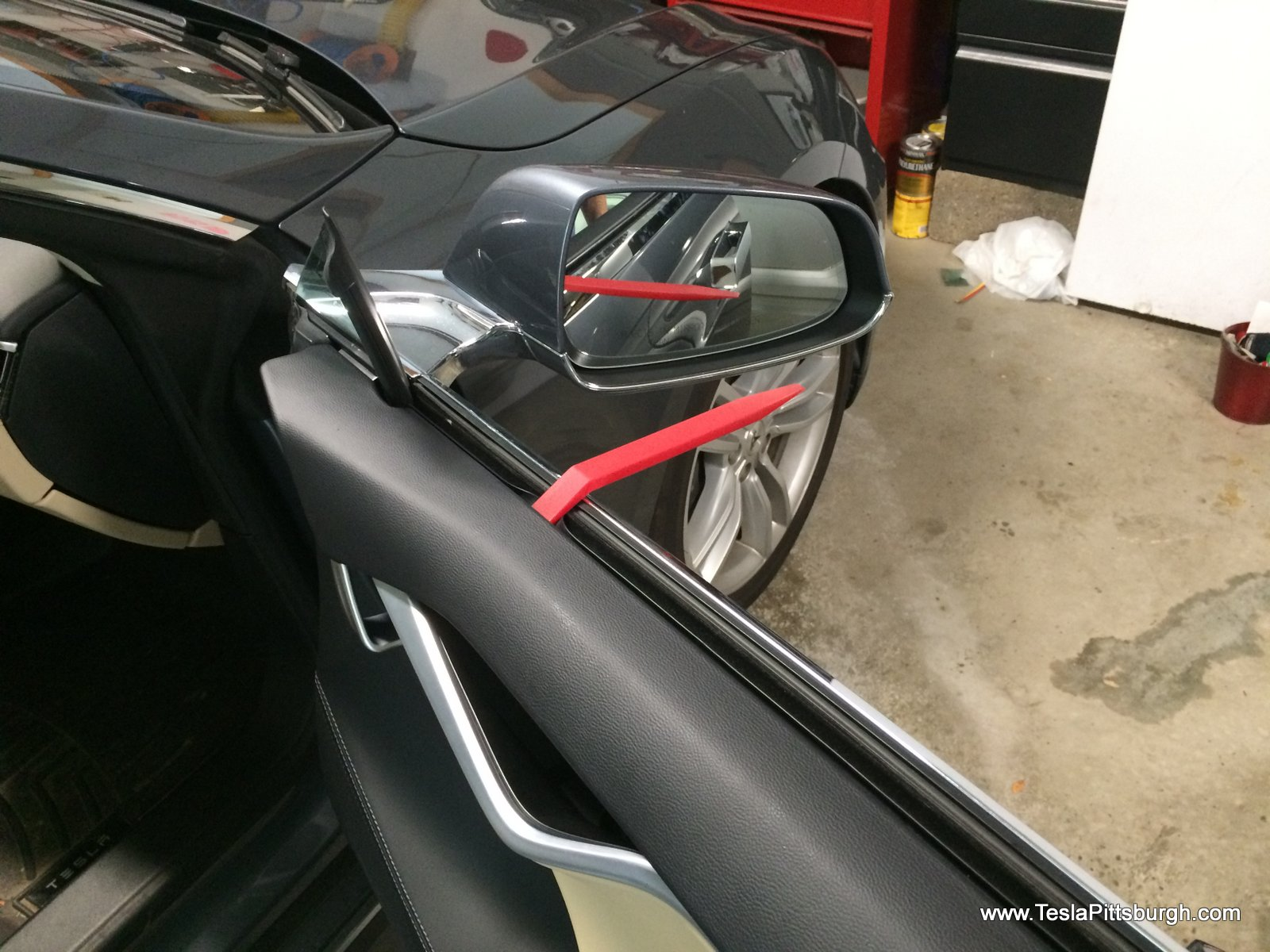 prying off the front door panels to install speakers tesla pittsburgh