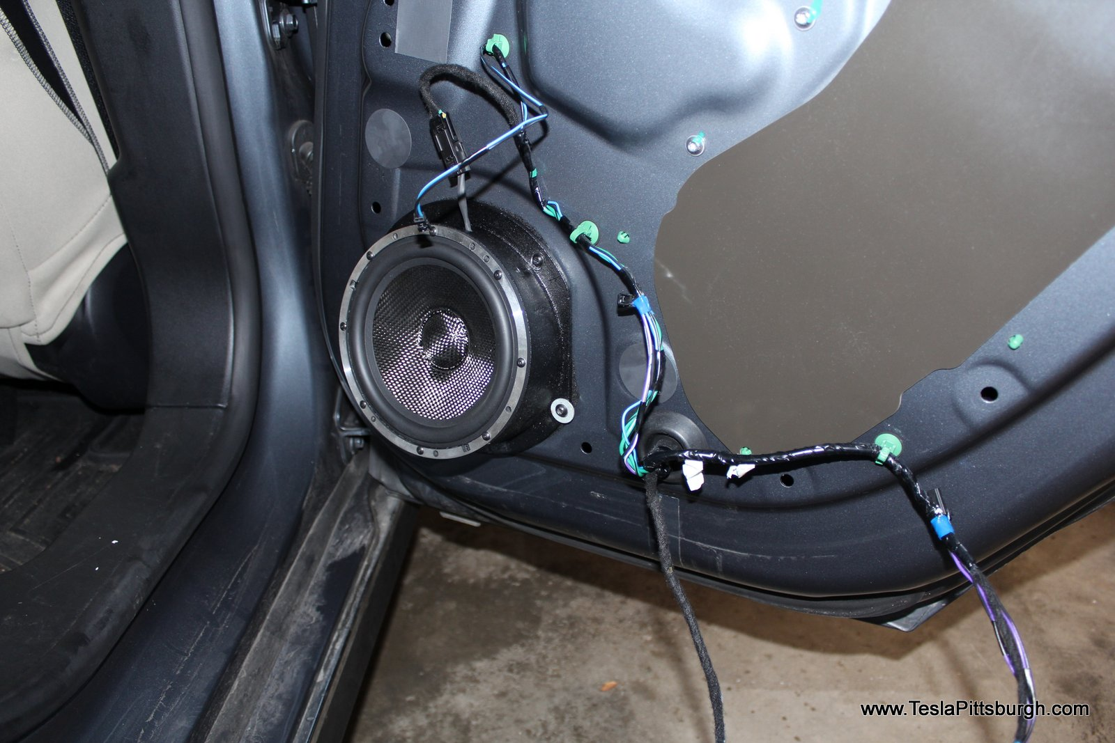 rear door mounted with washers of light harmonic labs speakers tesla pittsburgh