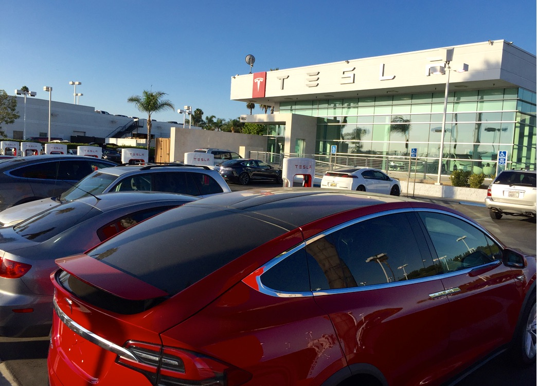 Red Model X in front of Tesla Buena Park