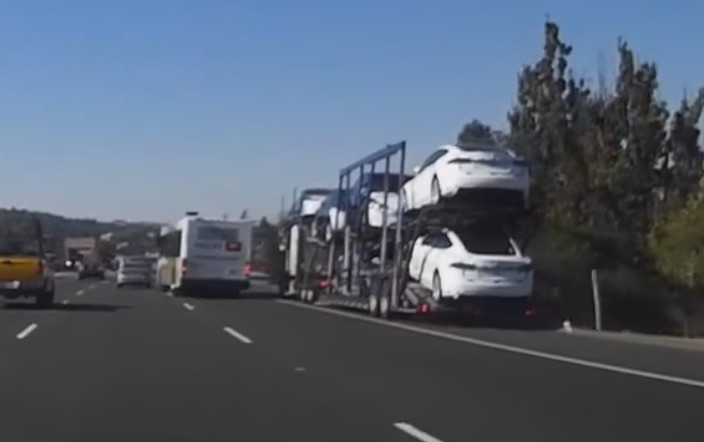commuter-bus-cuts-off-tesla-truck