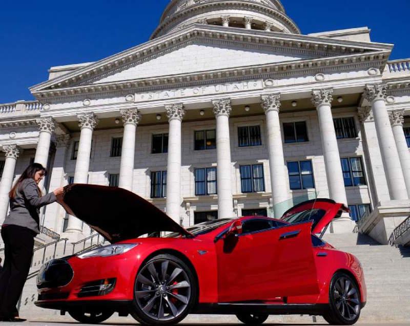 Red Tesla Model S parked in front of Utah Capitol [Credit: Francisco Kjolseth | Tribune file photo]