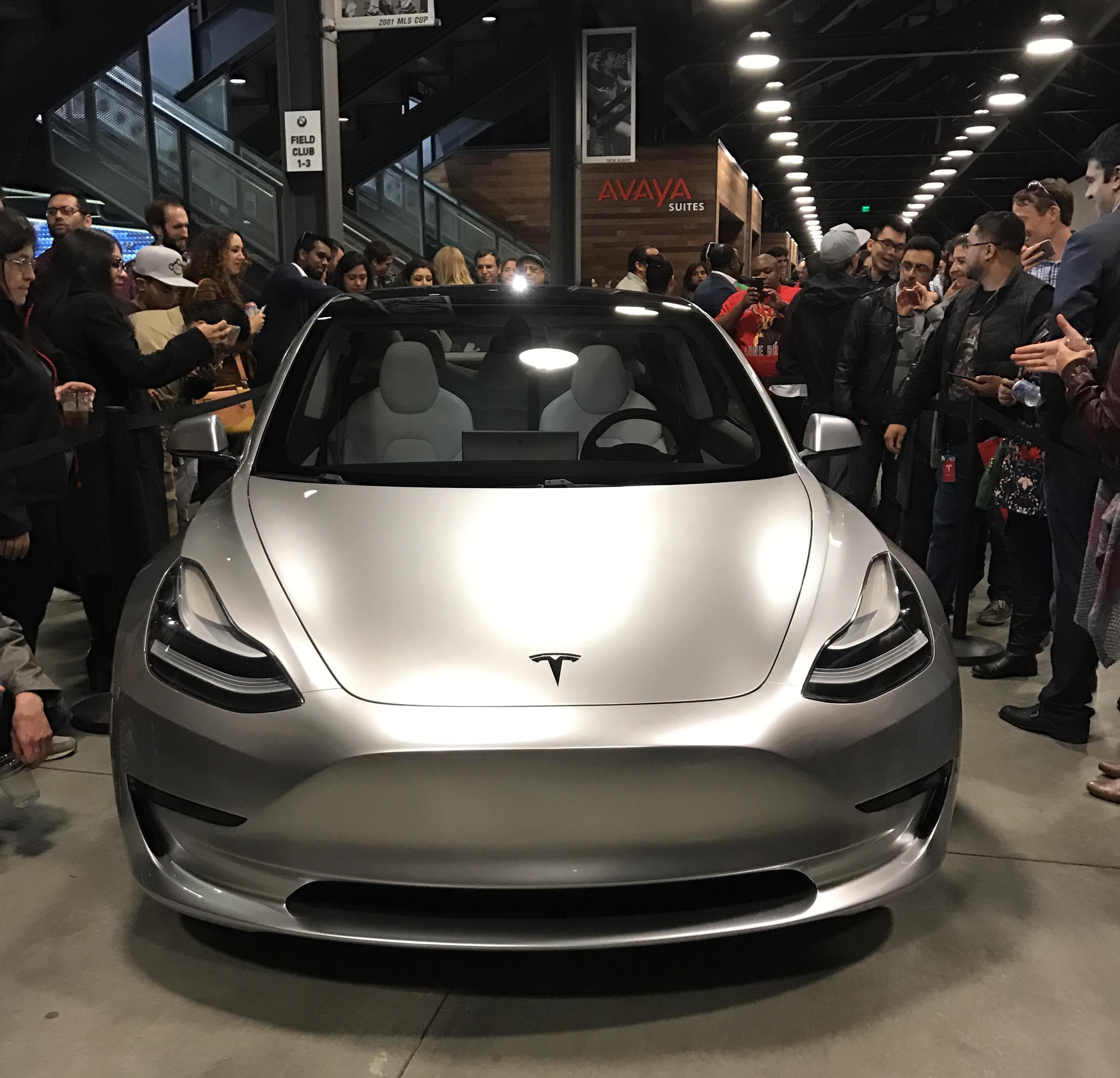 silver-tesla-model-3-front-employee-party-3