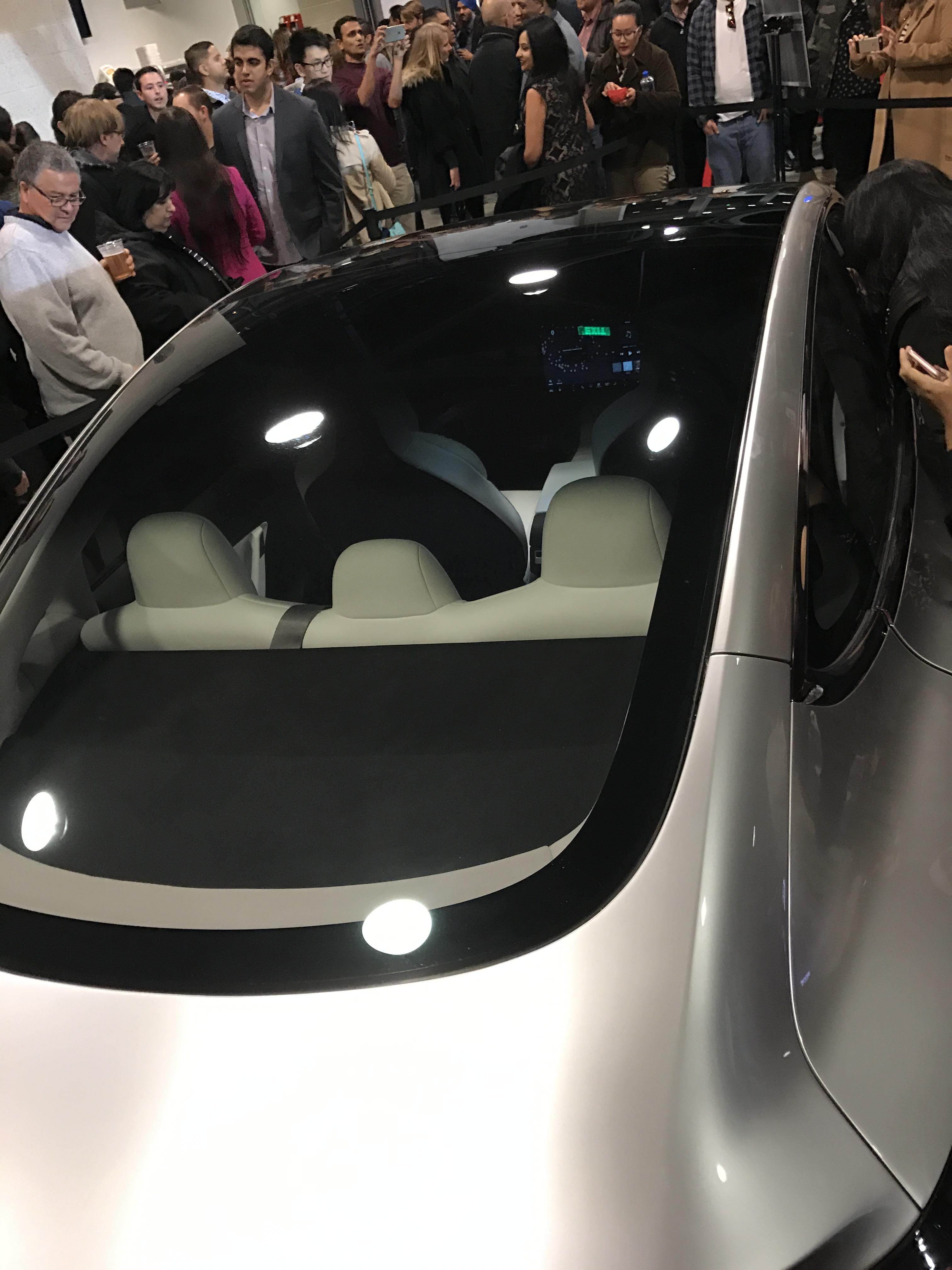 Silver Tesla Model 3 Glass Roof the Avaya Stadium [Credit: ryaneager via imgur]
