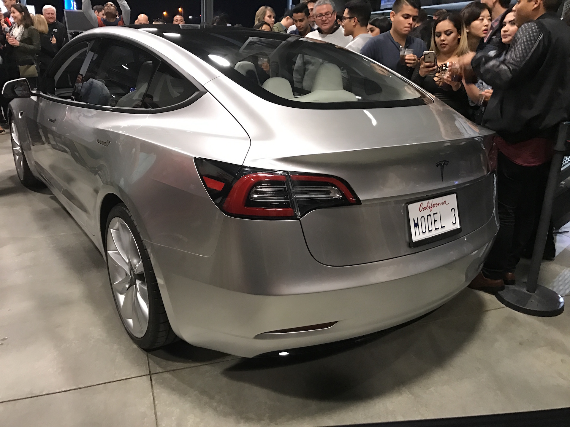 silver-tesla-model-3-trunk-employee-party