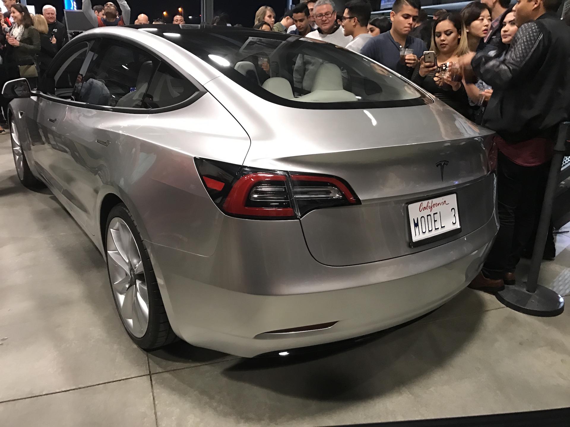 silver-tesla-model-3-trunk-employee-party