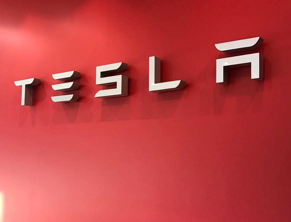 tesla-logo-red-sign