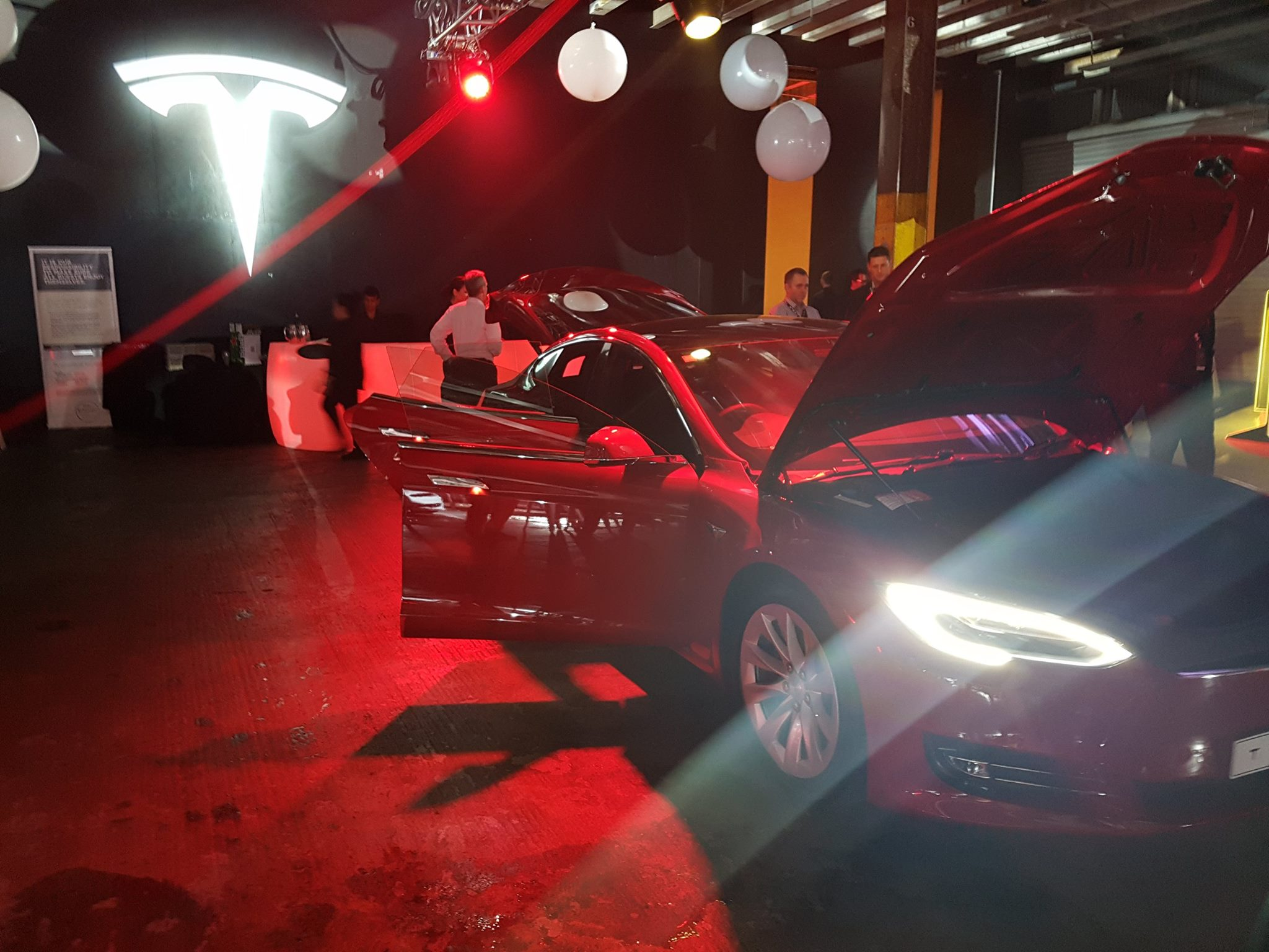 Tesla_delivery-event-auckland-new-zealand-red-model-s