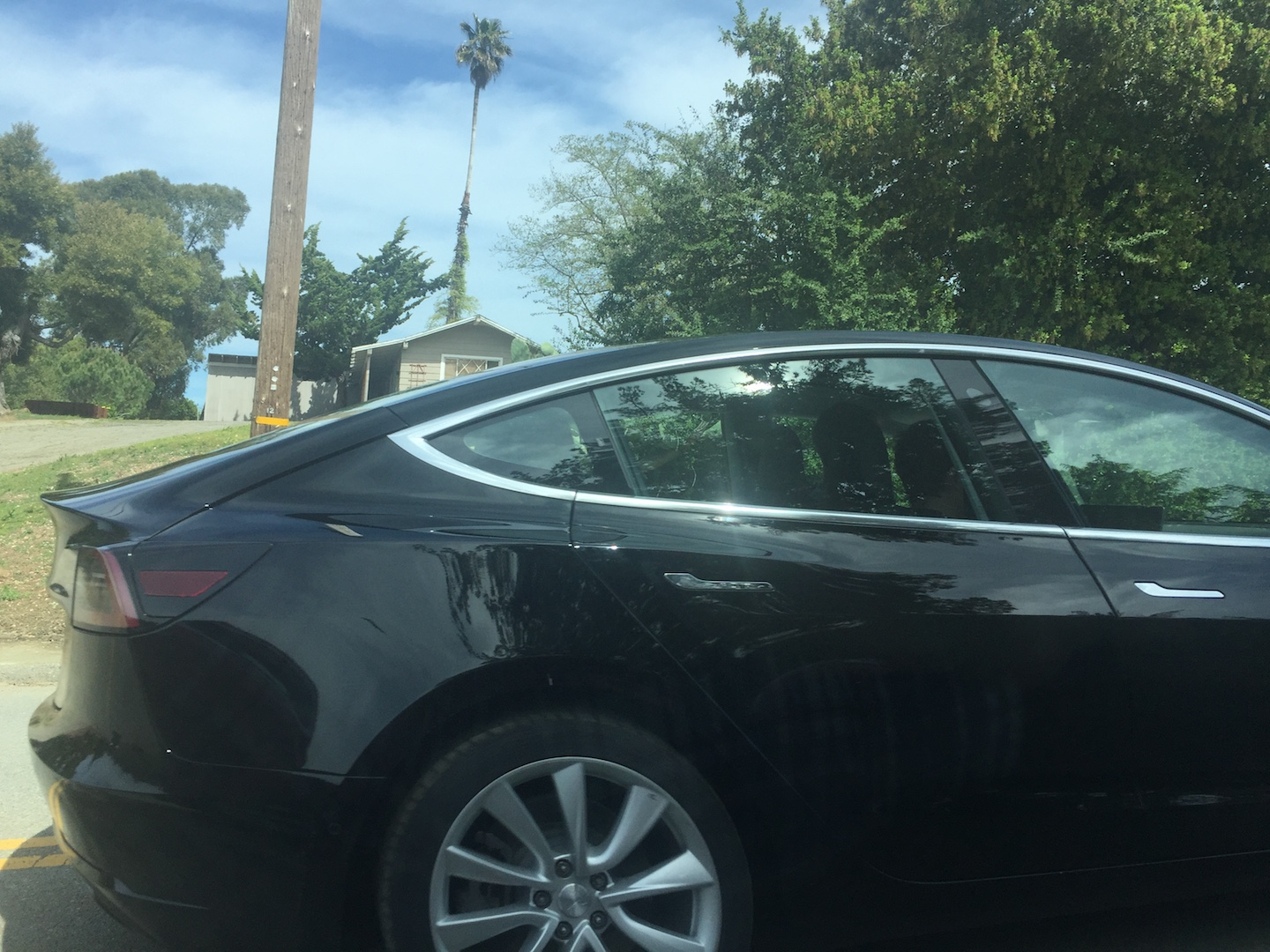 Black-Tesla-Model-3-release-candidate-autopilot-side-camera-2