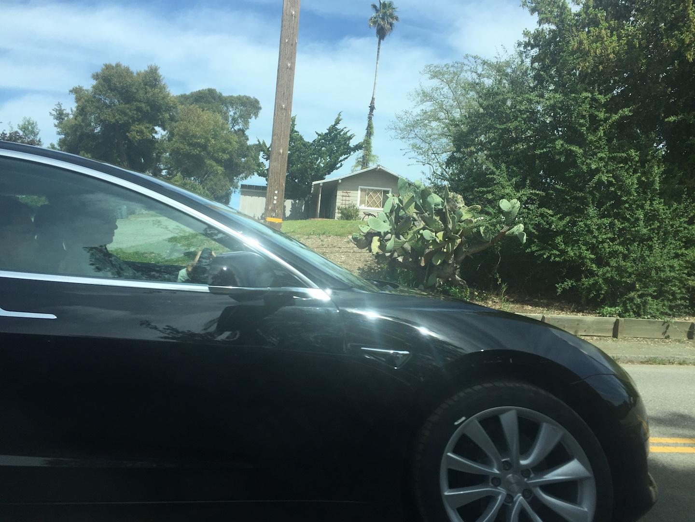 Black-Tesla-Model-3-release-candidate-autopilot-side-camera-turn-signal-badge