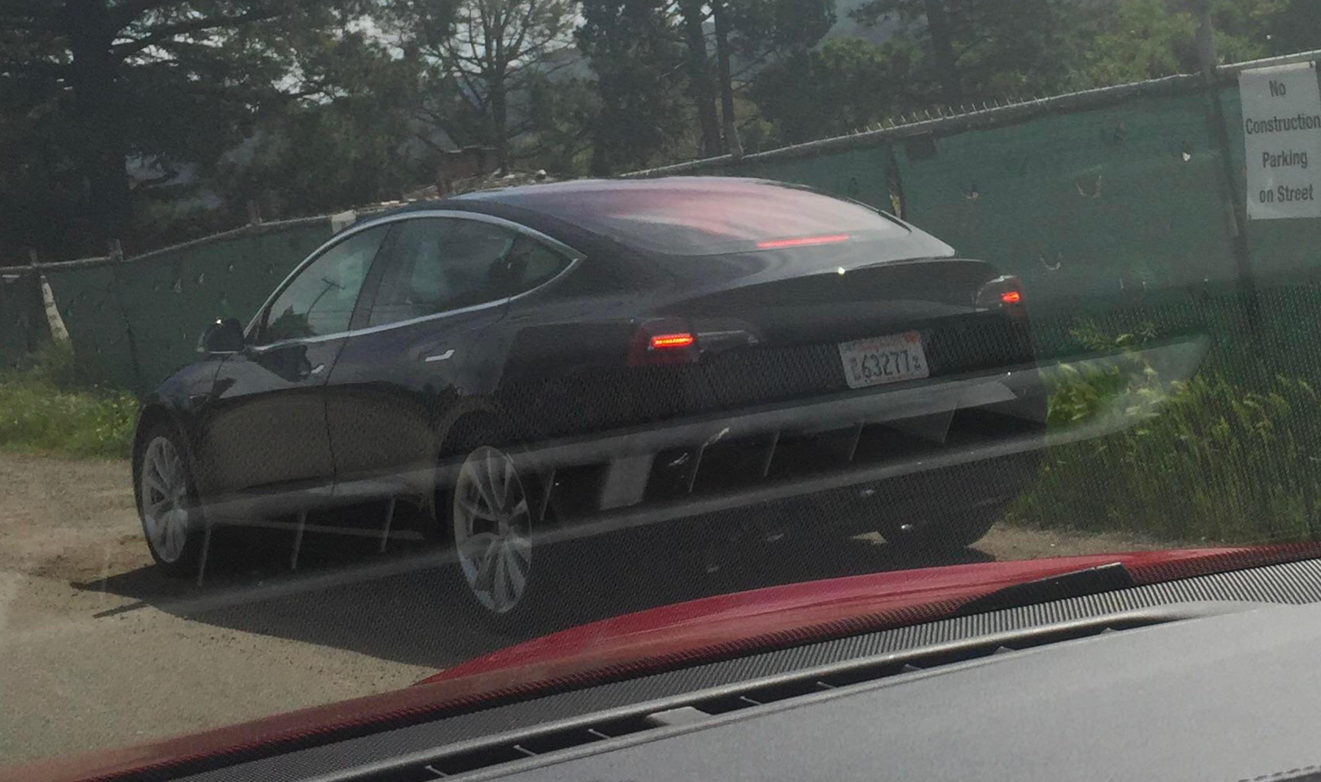 Black-Tesla-Model-3-release-candidate-rear