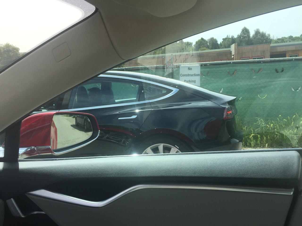 Black-Tesla-Model-3-release-candidate-side-rear
