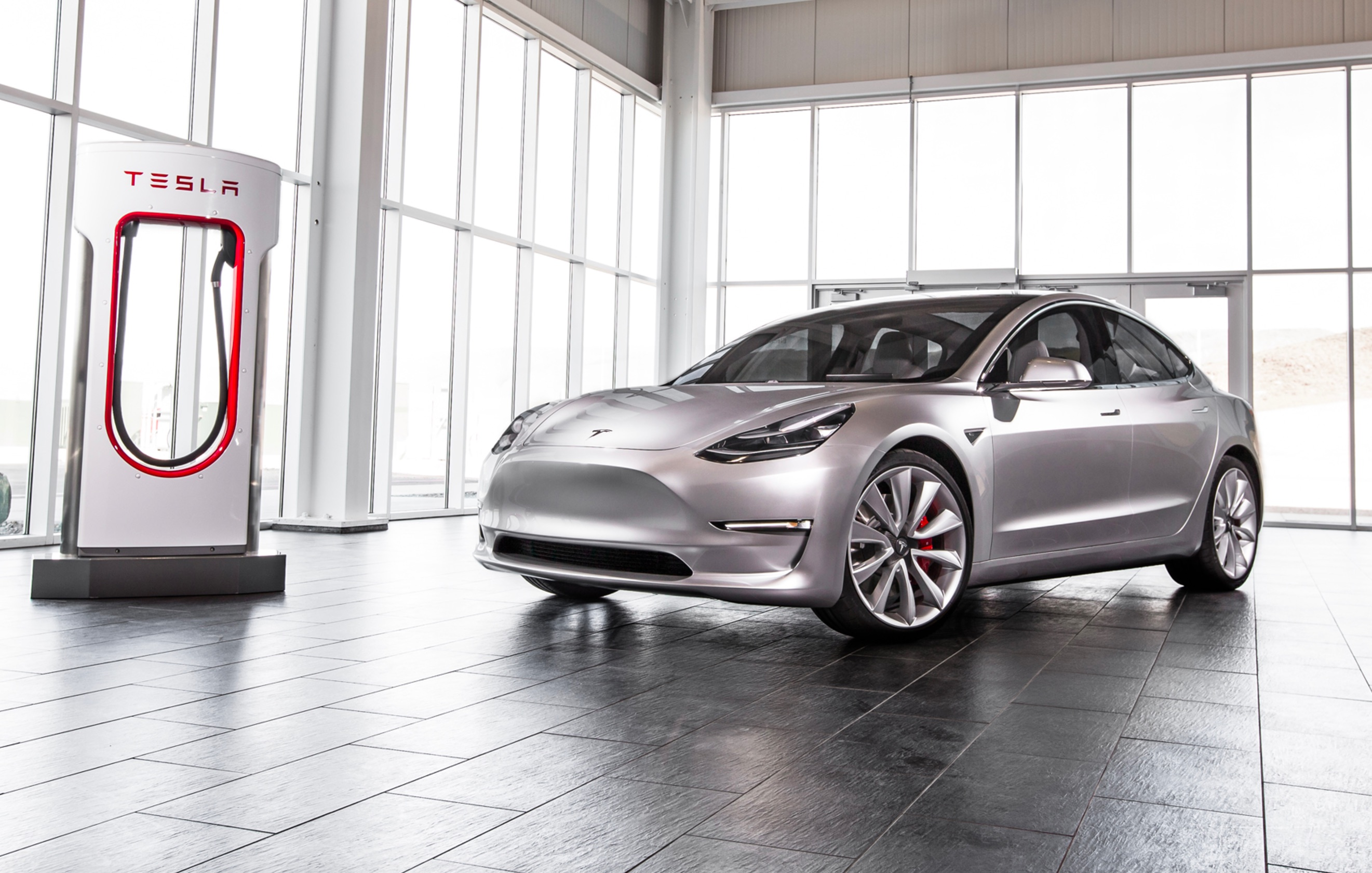 Tesla-Model-3-frt-three–quarter-Supercharger