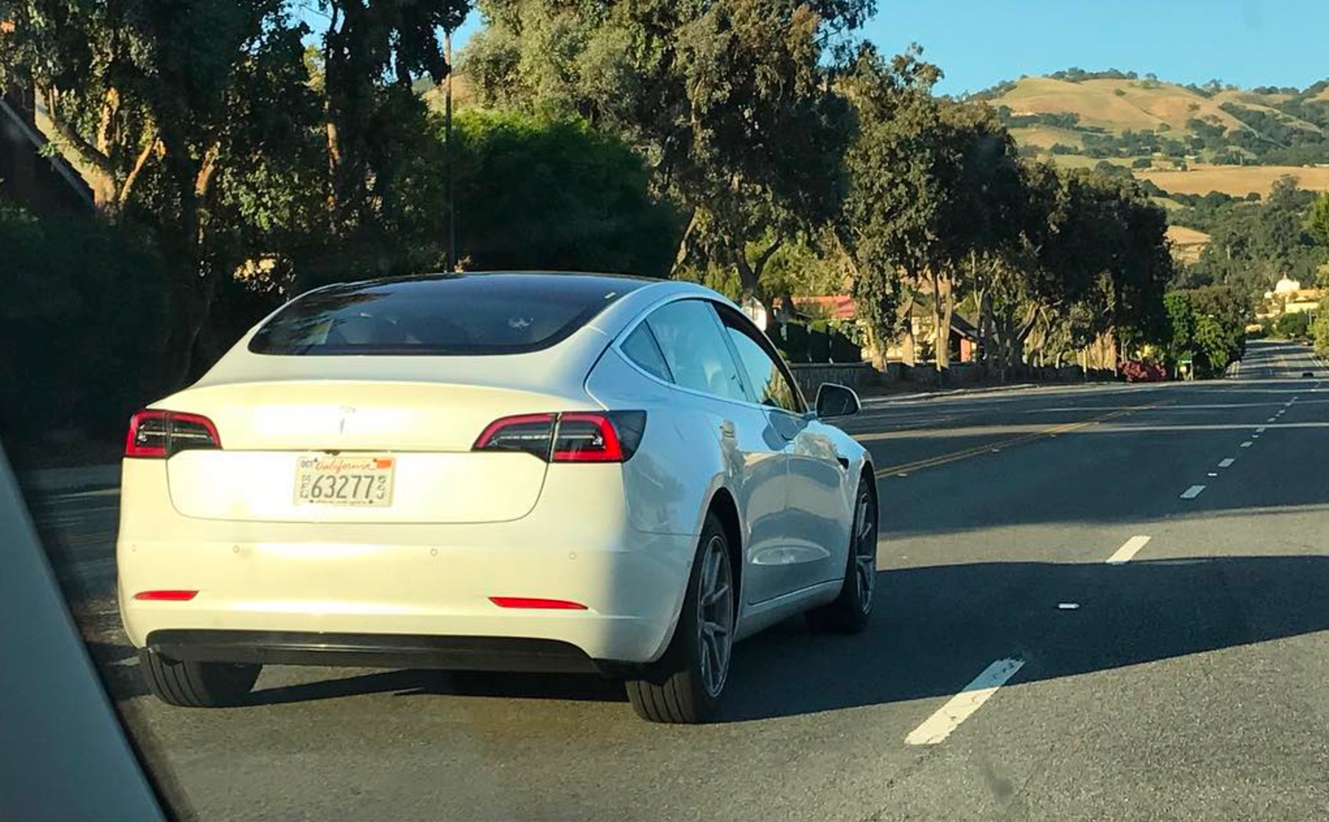 tesla model 3 in white spotted on the hwy is a foreshadow of what 39 s to come. Black Bedroom Furniture Sets. Home Design Ideas