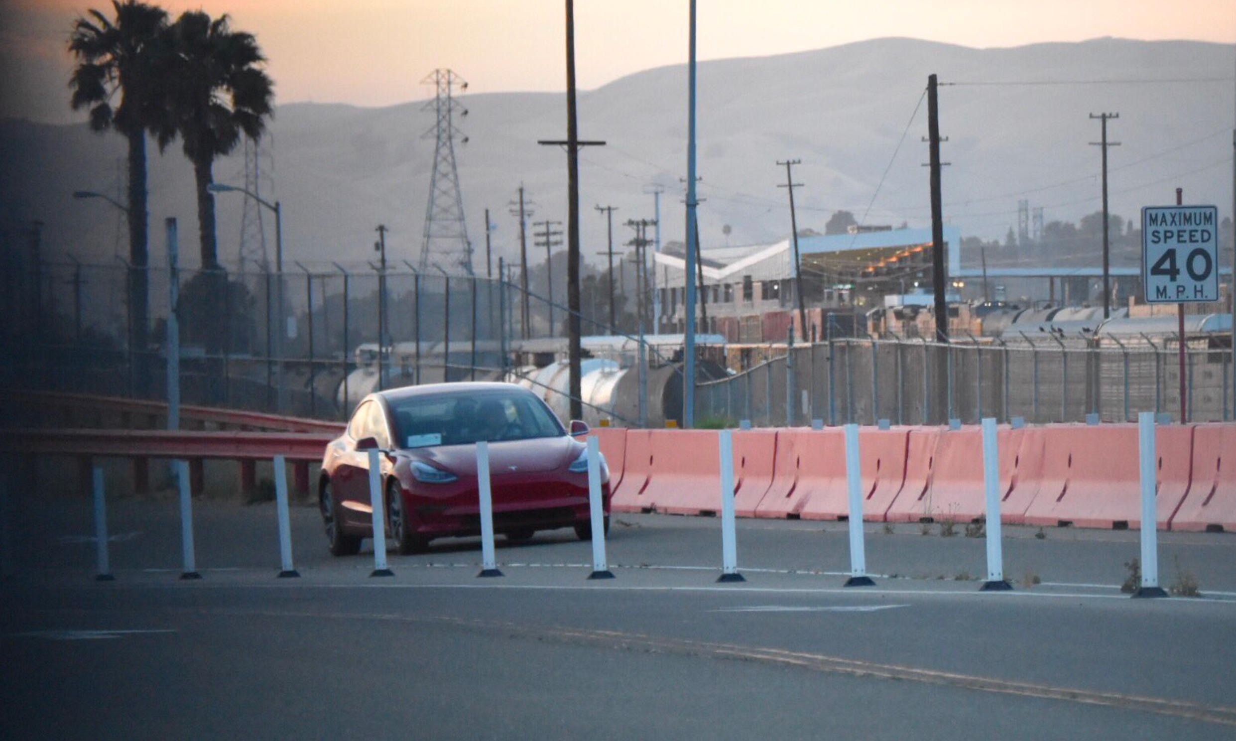 Red Tesla Model 3 at the Fremont Factory test track [Credit: Tesla Owners Club BE]