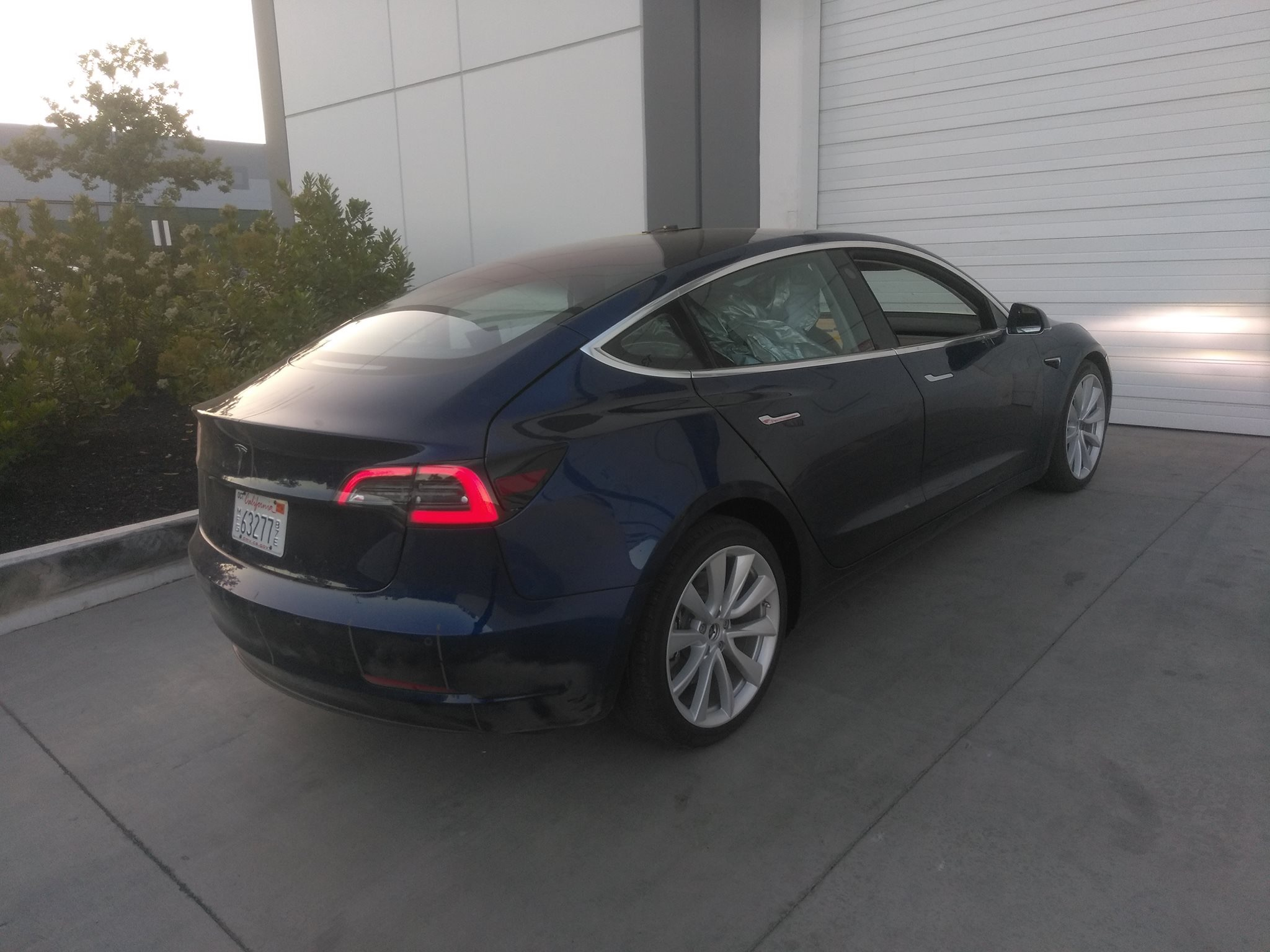 Tesla Model 3 with split folding rear seats spotted near ...