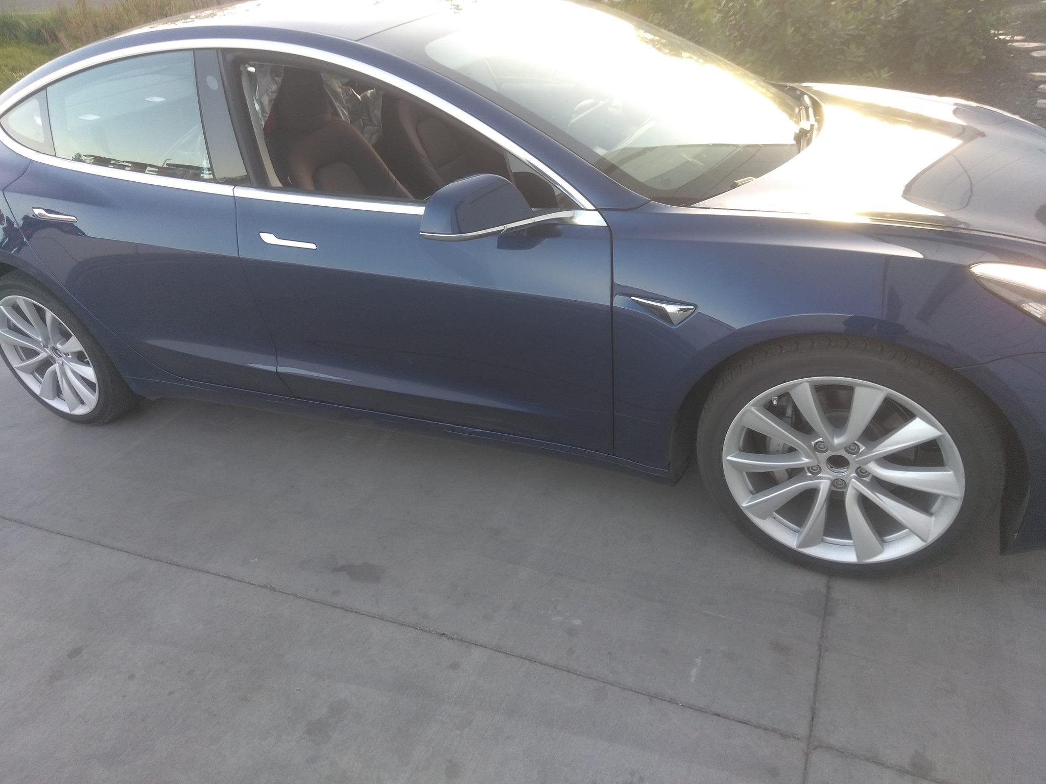 blue-tesla-model-3-folding-rear-seats