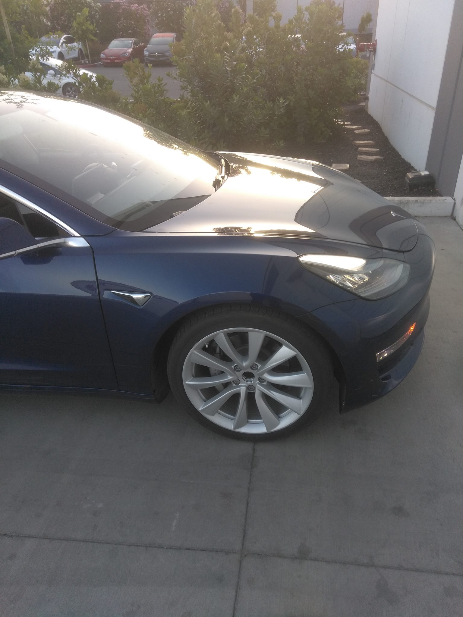 blue-tesla-model-3-front-right