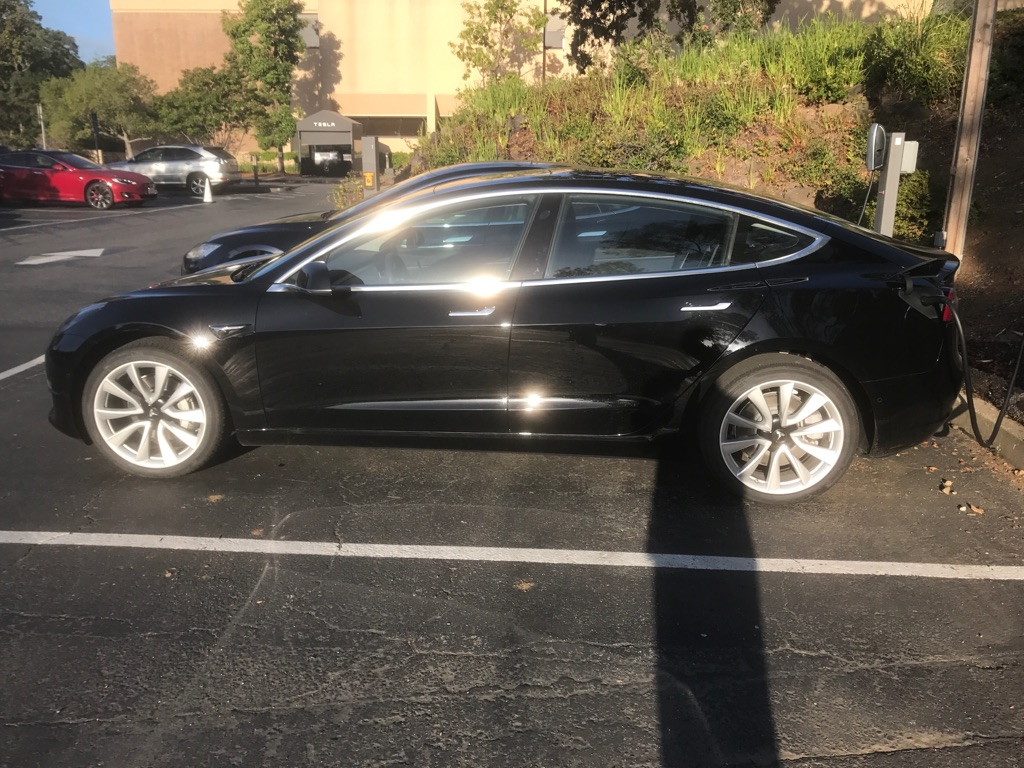 black-tesla-model-3-side-palo-alto-hq